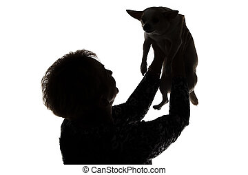 Silhouette of a woman with the dog