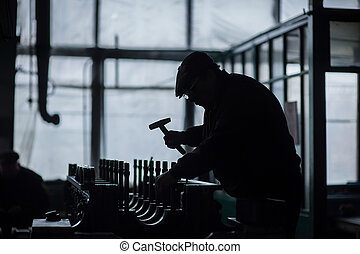 silhouette of a working man with tools