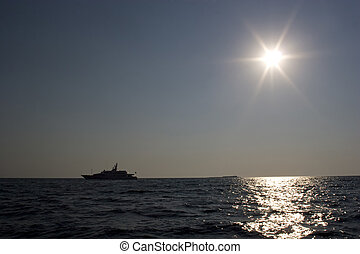 Silhouette of a yacht in the Aegean