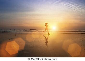 young jogger girl running through