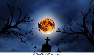 Silhouette of a young witch flying on a broomstick against the background of the orange moon. Halloween. Over old trees and graveyard