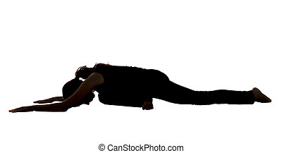 Silhouette of a young woman in Pigeon pose in Yoga