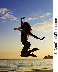 silhouette of a young woman jumpin