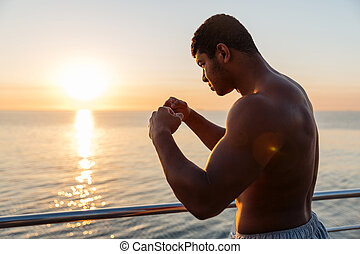 Silhouette of african man athlete doing boxing training in morning