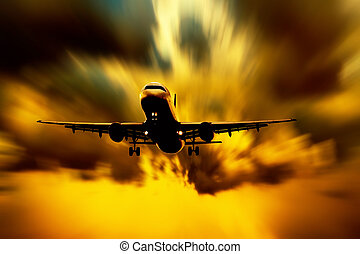 Silhouette of airplane on sunset sky