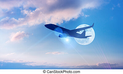 Silhouette of Airplane take off on the Colorful dramatic sky with cloud at full moon background