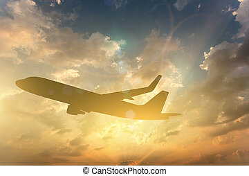 Silhouette of Airplane take off on the Colorful dramatic sky with cloud at sunset background
