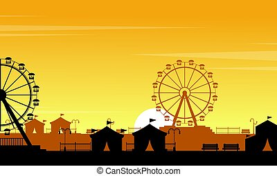Silhouette of amusement park with orange sky scenery
