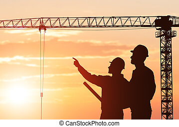 Silhouette Of An Architect Showing Something To His Partner