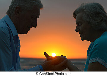 Silhouette of an elderly couple