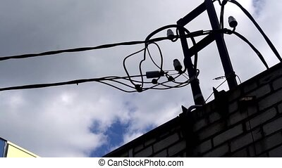 Silhouette of an electrician climbing a newly installed...