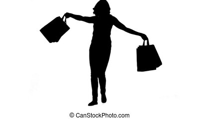 Silhouette of an energetic woman holding shopping bags