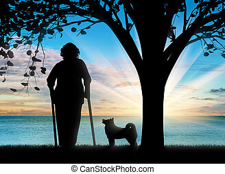 Silhouette of an old woman on crutches and her dog