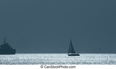 Silhouette of an unknown cruising sailboat near Gibraltar -...
