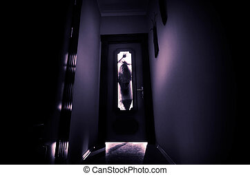 Silhouette of an unknown shadow figure with hands on a door through a closed glass door. Horror concept
