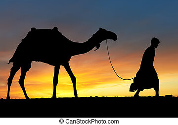 Silhouette of Arab with camel at sunrise - Silhouette of ...