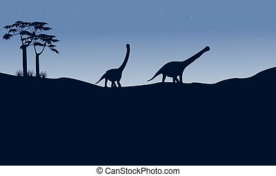 Silhouette of argentinosaurus on the hill