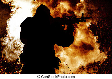 Silhouette of army soldier on burning battlefield