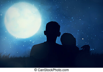 Silhouette of asian couple looking the moon