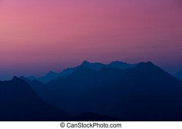 silhouette of austrian mountsains at sunrise