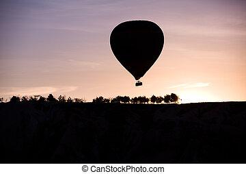 Silhouette of balloon at sunrise in Cappadocia