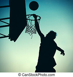 Silhouette of Basketbal Player - Toned Photo of Silhouette a...