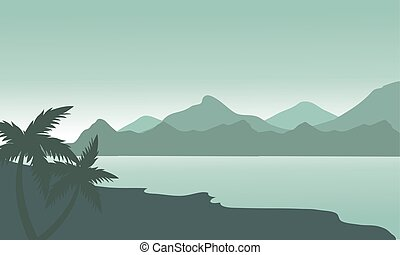 Silhouette of beach and mountain