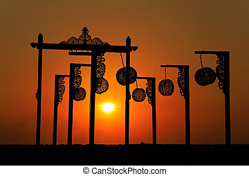 Silhouette of beach decorations at sunset