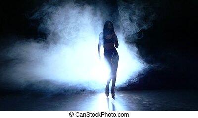 silhouette of beautiful stripper. Slow motion. smoke