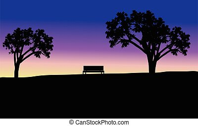 Silhouette of bench in fields