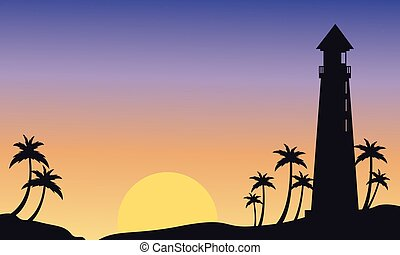 Silhouette of big lighthouse at sunset