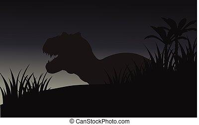 Silhouette of big tyranosaurus with grass