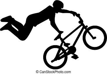 Silhouette of bmx rider stunt