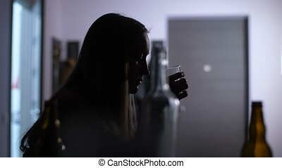 Silhouette of boozer woman in alcohol addiction