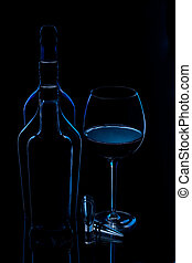 silhouette of bottles with glass of wine