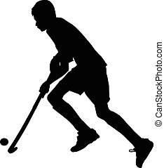 Silhouette of boy hockey player running with ball