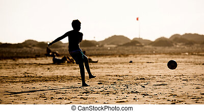 Silhouette of boy on the beach