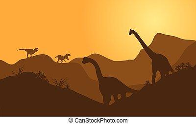 silhouette of brachiosaurus in hills