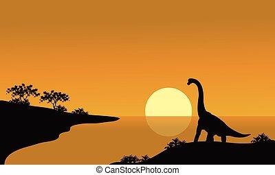 silhouette of brachiosaurus in river
