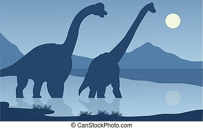 Silhouette of brachiosaurus lake