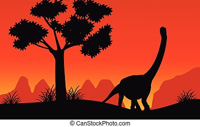 Silhouette of brachiosaurus on the hill