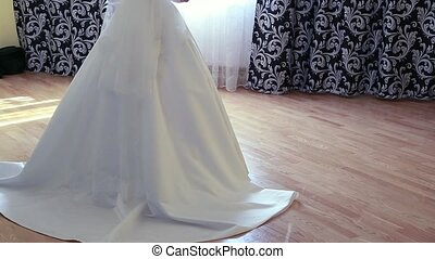 Silhouette of bride besides the window wedding