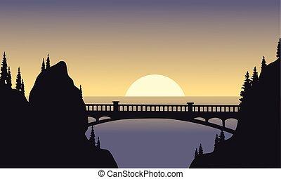 Silhouette of bridge and moon