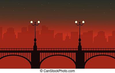 Silhouette of bridge with lamp landscape