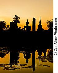 Silhouette of Buddha at sunset