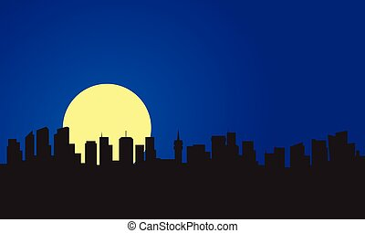 Silhouette of building and full moon