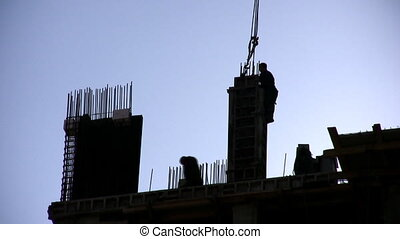 Silhouette of building house and crane, zoom out