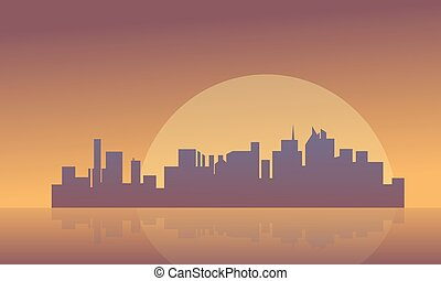 Silhouette of buildings and big moon