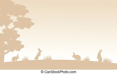 Silhouette of bunny on garden landscape
