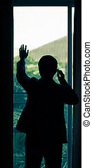 Silhouette of business man  talking on cell phone
